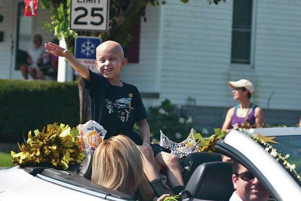 Jonny Wade tosses candy in September of 2015 while performing his duties as that year's grand marshal in the Bethalto Labor Day Parade.