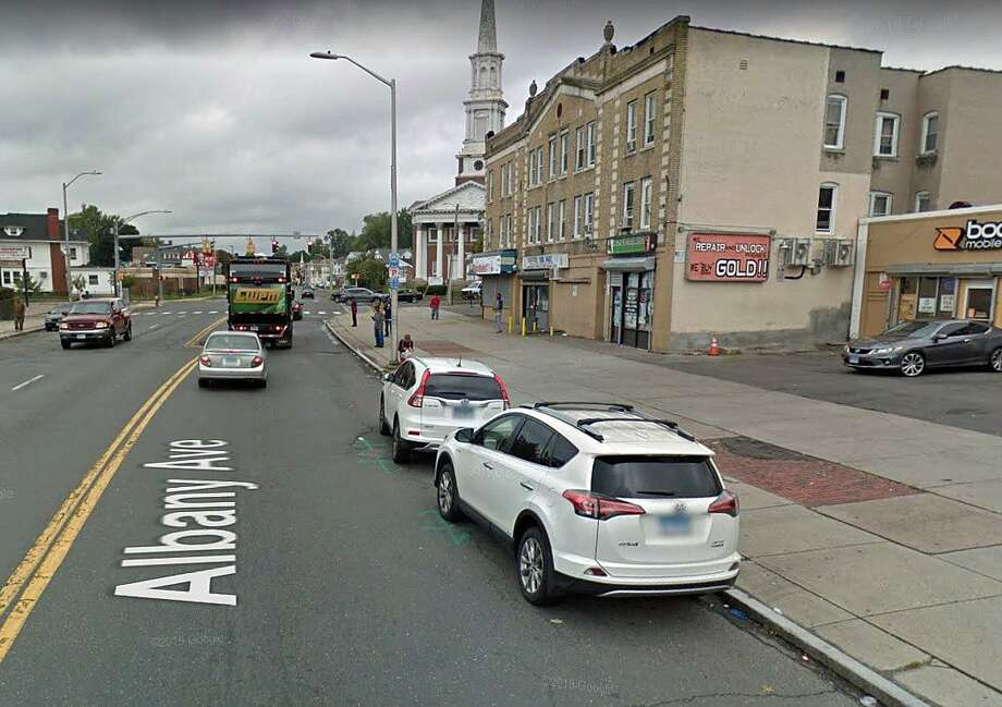 Detectives are investigating the shooting death of a 16-year-old who found in a crashed vehicle at 800 Albany Ave. in Hartford early Wednesday morning, police said. Photo: Google Street View Image