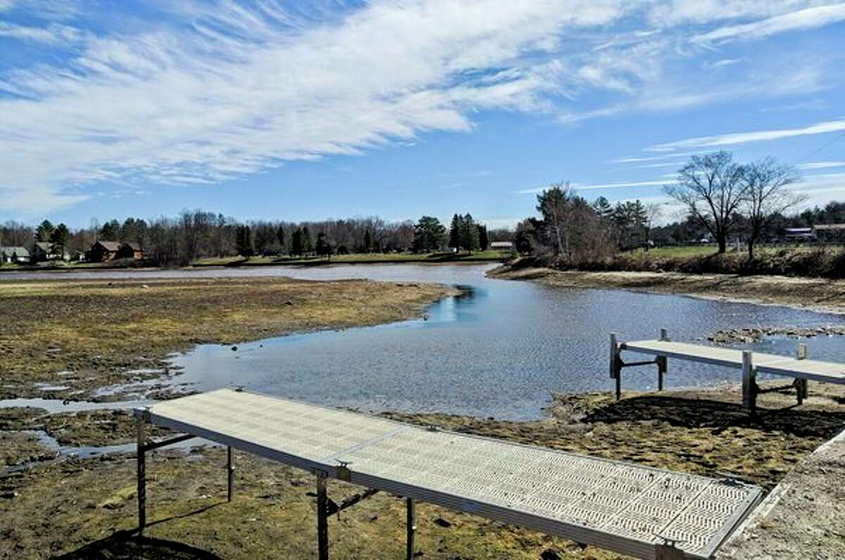 FILE - Small puddles of water cover Wixom Lake Saturday, as seen from the Wixom Lake Gas and Launch. Four Lakes Task Force board members are hoping to see a rise by Memorial Day. The lake is down eight feet. (Teresa Nims/for the Daily News)