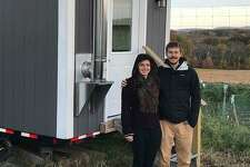 James Southworth and Julia Waite infront of their tiny house in Weston.