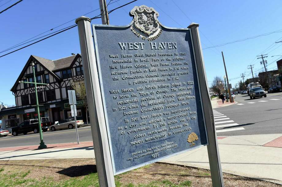 A sign detailing the history of West Haven in front of West Haven City Hall. Photo: Arnold Gold / Hearst Connecticut Media / New Haven Register