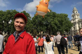 "Leo Murray, in London's Parliament Square in 2018. Murray, an environmentalist, came up with the idea for the ""Trump Baby"" balloon."