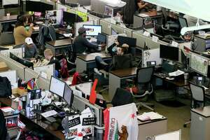 Several Rackers break for lunch at their desks on Wednesday, March 6, 2019.