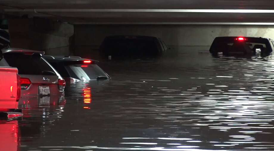Some vehicles parked at Dallas Love Field Airport were almost completely submerged in water Wednesday morning as several rounds of heavy rain continue to drench North Texas. Photo: Metro Video