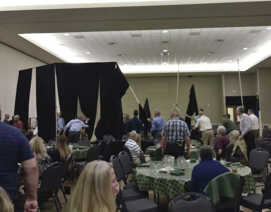 The storms that blew in last Wednesday also made their way inside to the Lone Star Convention Center during the Conroe Noon Lions Club luncheon as backdrop curtains came tumbling down during the meeting.