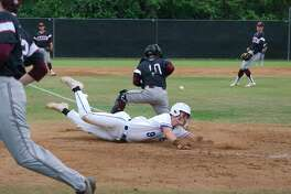 Clear Springs' Cameron Cooper (9) slides past Clear Creek's Andrew Cardi (10) for a score Tuesday, Apr. 23 at Clear Springs High School.