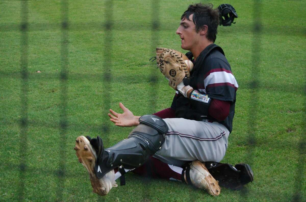 Clear Creek's Andrew Cardi (10) slides to catch a foul ball for an out against Clear Springs Tuesday, Apr. 23 at Clear Springs High School.