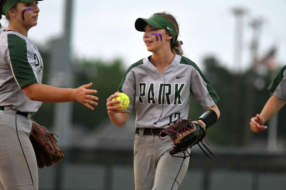 Kingwood Park centerfielder Camryn Reno, center, is greeted in the infield by teammate Hannah Wilburn, left, after making a running catch deep in right-centerfield against Willis in the bottom of the fourth inning of their District 20-5A matchup at KPHS on April 16, 2019. Photo: Jerry Baker, Houston Chronicle / Contributor / Houston Chronicle