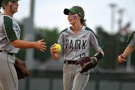 Kingwood Park centerfielder Camryn Reno, center, is greeted in the infield by teammate Hannah Wilburn, left, after making a running catch deep in right-centerfield against Willis in the bottom of the fourth inning of their District 20-5A matchup at KPHS on April 16, 2019.