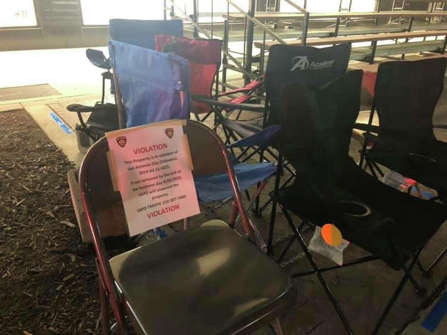 Chairs put out to reserve spots along the Battle of Flowers parade route downtown are being targeted by SAPD. The department is enforcing a city ordinance banning chairs on the sidewalk before Thursday at 3 p.m. Photo: Rebecca Salinas/San Antonio Express-News