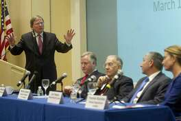 Joseph McGee, Vice President, Public Policy and Programs for the Business Council of Fairfield County, moderates a 2015 panel in Stamford including State Speaker of the House Brendan Sharkey, State Senate President Martin Looney, State Senate Minority Leader Len Fasano, and State House Minority Leader Themis Klarides. McGee is prodding the Connecticut Business and Industry Association to take a position on tolls.