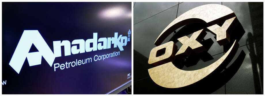 This combo of file photos shows the logo for Anadarko Petroleum Corp. on the floor of the New York Stock Exchange on April 12, 2019, left, and a logo on the Occidental Petroleum building in Los Angeles on  Jan. 26, 2010. A bidding war is breaking out over Anadarko Petroleum, with Occidental making an offer worth $76 per share in cash and stock that it says is about a 20% premium to Chevron's $33 billion deal. (AP Photos) Photo: Reed Saxon, Associated Press / AP2010
