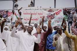 Demonstrators chant protests slogans at a sit-in in Khartoum, Sudan.
