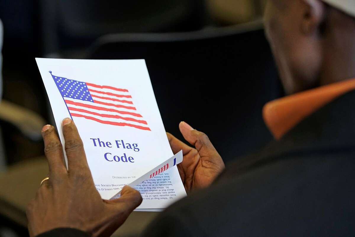 SALT LAKE CITY, UT - APRIL 10: An applicant looks at a pamphlet on the American flag while waiting to take the oath to become a U.S. citizen at a Naturalization Ceremony on April 10, 2019 in Salt Lake City, Utah. There were 49 people from 26 countries that became U.S. citizens. A group of Republican Senators are introducing a bill today to reduce legal immigration in the United States. (Photo by George Frey/Getty Images)