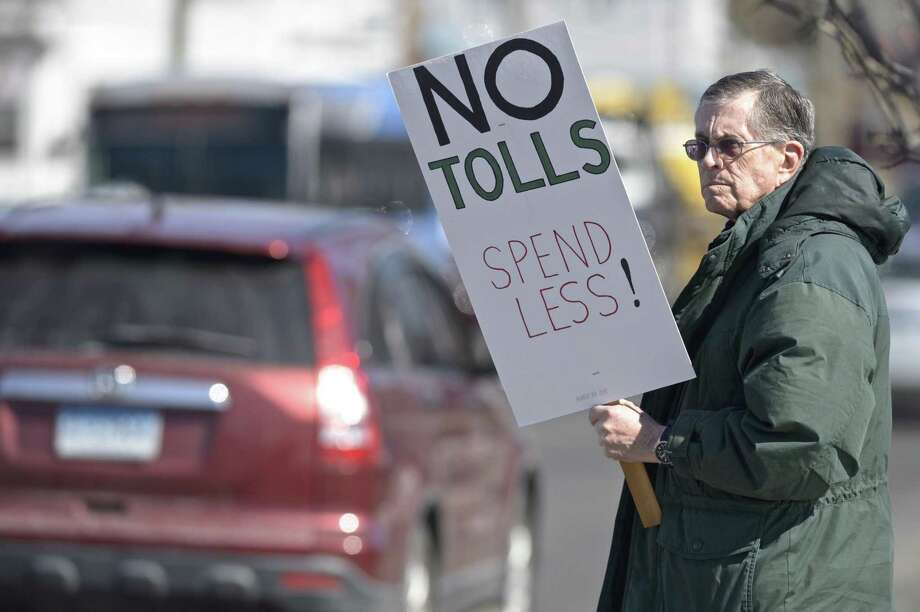 Harrison Pease, of Newtown, participates in an anti-toll protest at the intersection of White and Wildman Streets in Danbury in March. Photo: H John Voorhees III / Hearst Connecticut Media / The News-Times