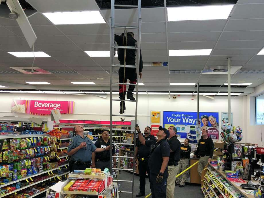 Burglary suspects hide inside CVS store ceiling and column, but can't escape from Wharton police