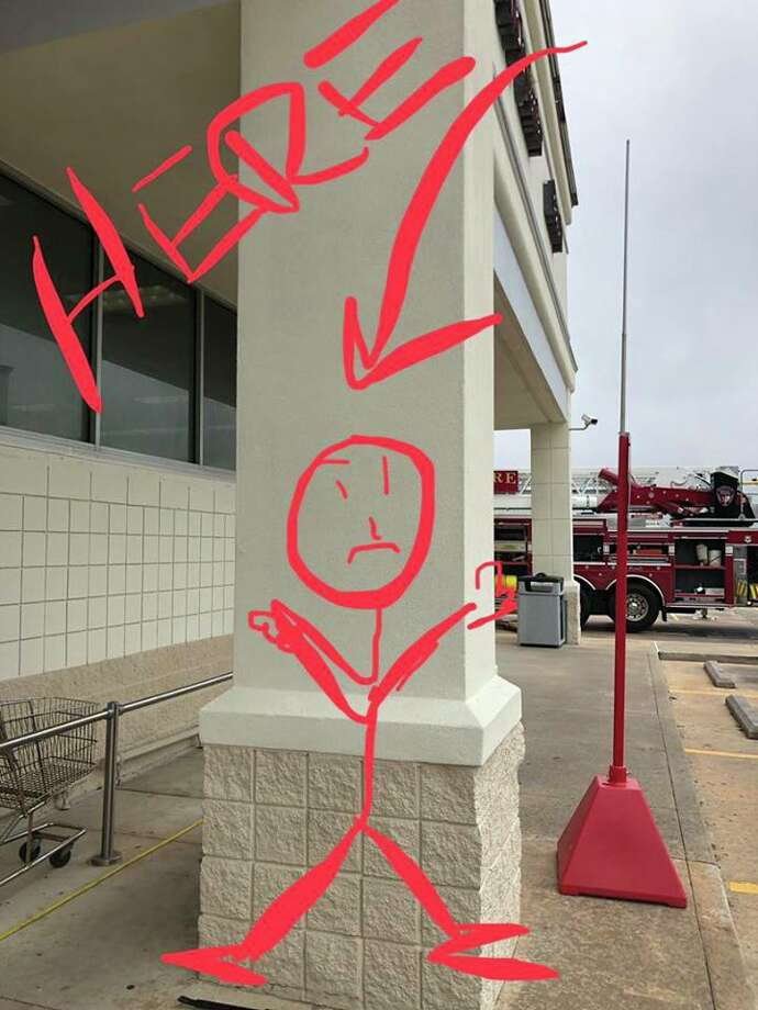 """Wharton Police Department Suspect three is hiding within and behind one of the exterior CVS columns (labeled here). We are in the process of attempting to remove him so he can safely be placed in custody. #UPDATE: @10:56a - suspect three (formally """"stick man"""") is IN CUSTODY. Photo: Wharton Police"""
