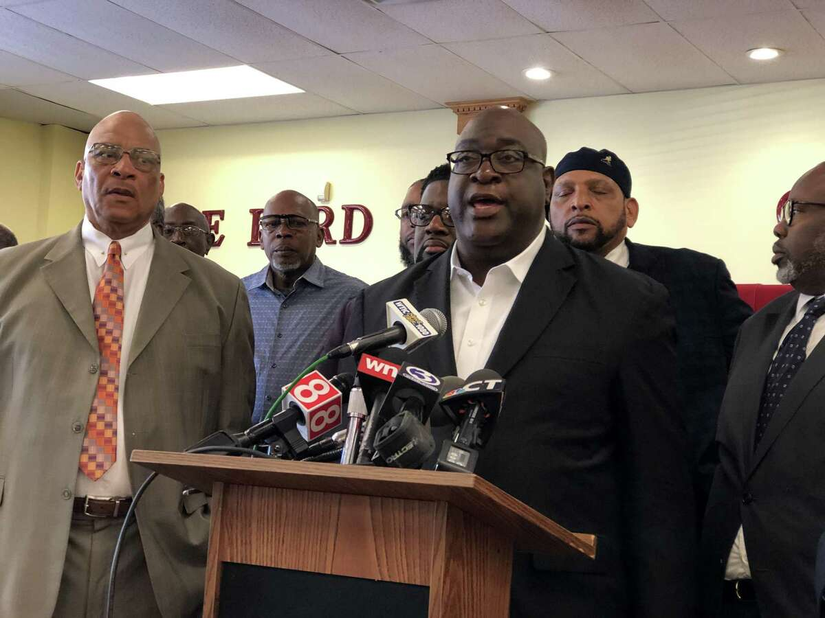 The Rev. Boise Kimber called for Officers Devin Eaton and Terrence Pollock, of the Hamden and Yale police respectively, to be fired immediately Wednesday. The two officers fired at the vehicle containing Paul Witherspoon and Stephanie Washington last Tuesday on Argyle Street in New Haven, wounding Washington.