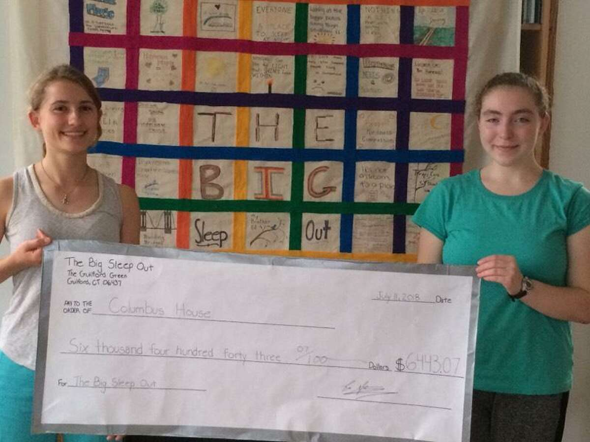 """Ella Stanley, left, holds a check with the amount of money raised for Columbus House through """"The Big Sleep Out"""" in 2018. Stanley, a student at Guilford High School, is the event organizer. This year it will be held on Saturday, April 27."""