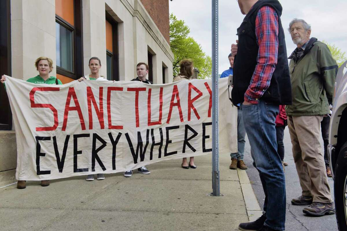 Members of the Troy Sanctuary Campaign whoare in favor of legislation that would provide illegal immigrants with driver's license take part in a rally outside the Rensselaer County DMV office on Wednesday, April 24, 2019, in Troy, N.Y. (Paul Buckowski/Times Union)