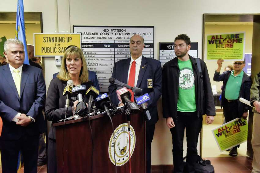 Senator Daphne Jordan along with other elected officials voice their opposition to legislation that would provide illegal immigrants with driver's license during a press event at the Rensselaer County DMV office on Wednesday, April 24, 2019, in Troy, N.Y. A group of people in favor of the legislation, on right in photo, showed up to protest at the press event. (Paul Buckowski/Times Union)