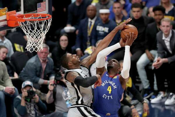 DENVER, COLORADO - APRIL 23: Paul Millsap #4 of the Denver Nuggets goes to the basket against Lemarcus Aldridge #12 of the San Antonio Spurs during first quarter of Game Five of the first round of the 2019 NBA Western Conference Playoffs at the Pepsi Center on April 23, 2019 in Denver, Colorado. NOTE TO USER: User expressly acknowledges and agrees that, by downloading and or using this photograph, User is consenting to the terms and conditions of the Getty Images License Agreement. (Photo by Matthew Stockman/Getty Images)
