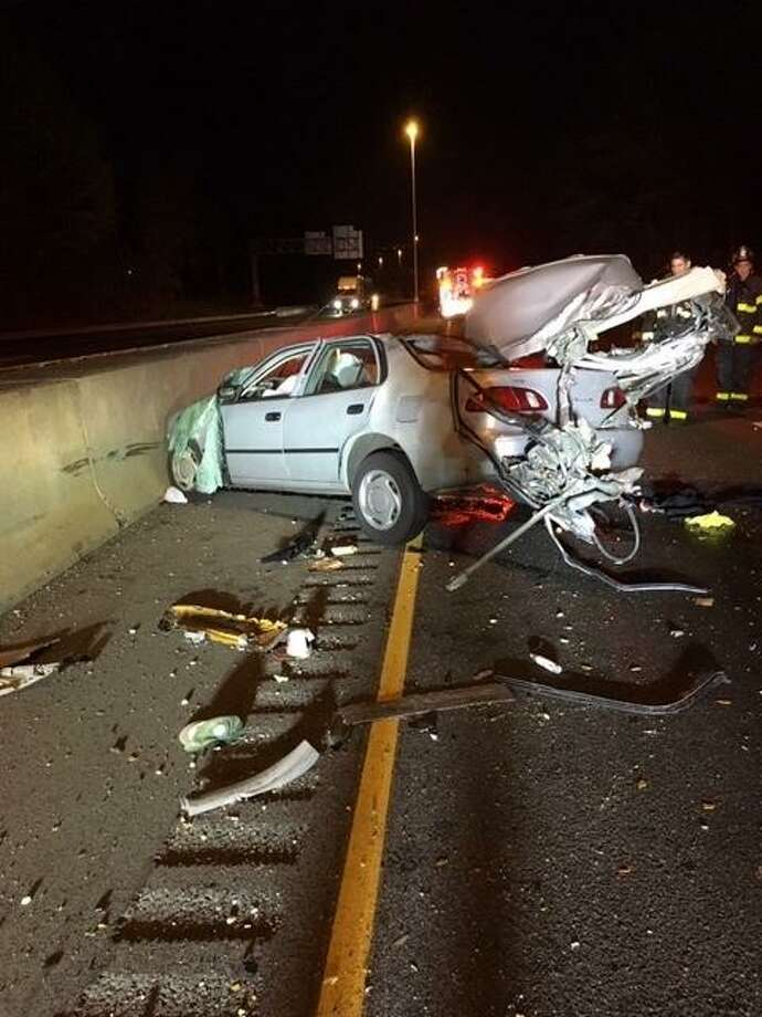 A 30-year-old man was seriously injured in a car crash around1:15 a.m. Tuesday on I-95. Photo: Norwalk Fire Dept.
