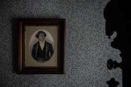 Frederick Douglass's framed photo is seen inside his room at his house in Washington.