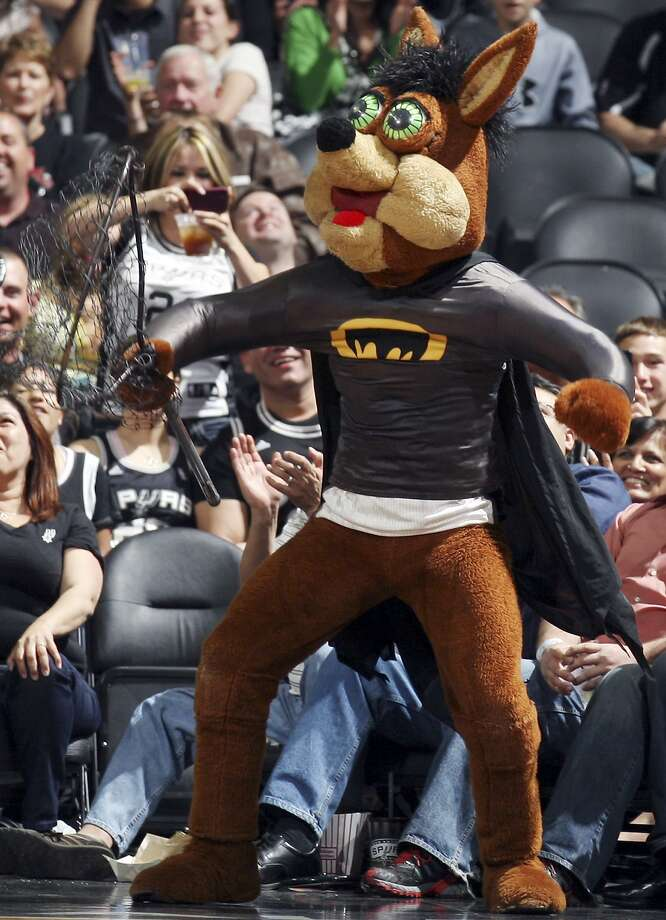 FILE - The Spurs Coyote wears a batman costume soon after Manu Ginobili swatted a bat down in mid-flight during a game. In a video posted to Twitter on Thursday, the Coyote runs around an empty AT&T Center with his T-shirt launcher, looking for fans to aim at. Of course, his big green eyes find none. Photo: Staff File Photo / SAN ANTONIO EXPRESS-NEWS NFS