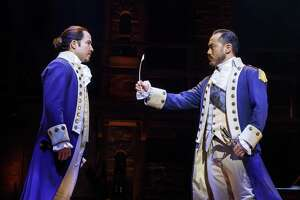"Marcus Choi (right, with Joseph Morales) plays George Washington in ""Hamilton."""