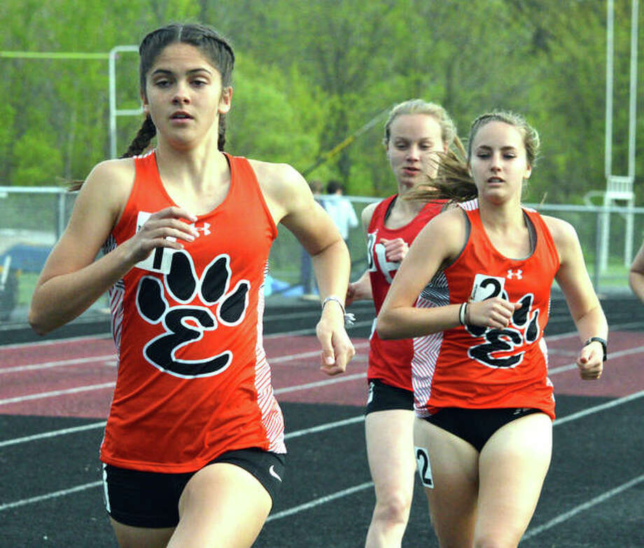 Edwardsville's Abby Korak runs in front of the pack, including teammate Hannah Stuart, on Tuesday in the Madison County Meet in Troy. Photo: Scott Marion/The Intelligencer