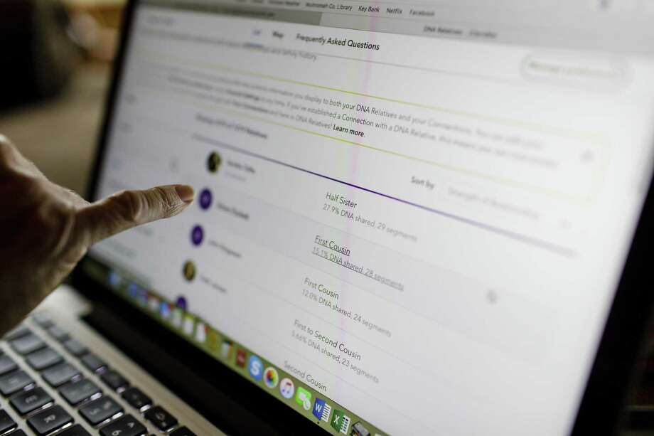 A woman logs on to 23andMe.com, a genetic testing web site at her home in Portland, Ore. Photo: File Photo / LeahNash.com