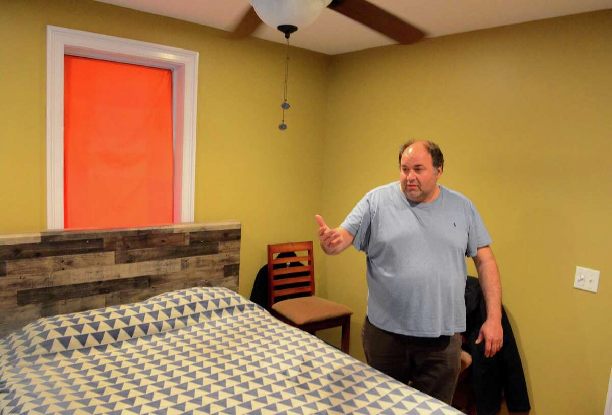 Bridgeport Board of Education member Chris Taylor shows the bedroom in his Davenport Street building in April. The Zoning Board of Appeals has ruled the property can be used as a residence.