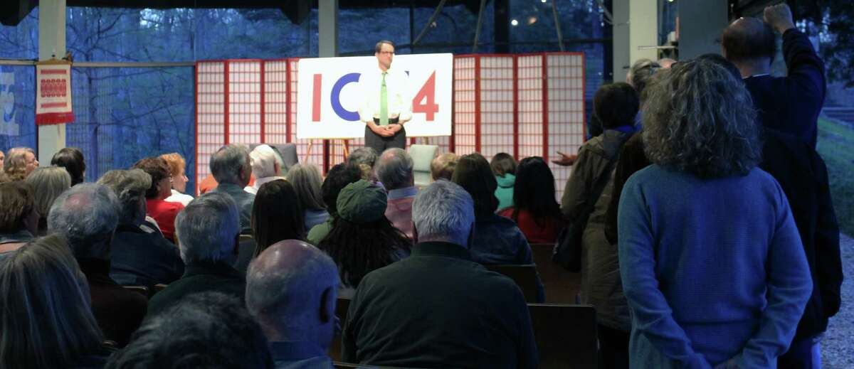 Representative Jim Himes spokea at a town hall event at The Unitarian Church in Westport on April 24.