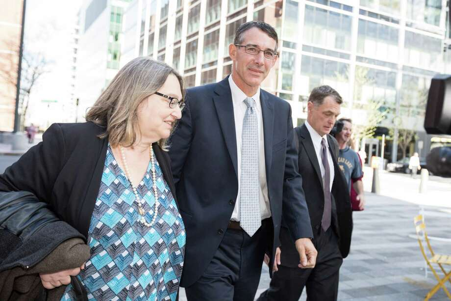 Michael Center, former men's tennis coach for UT Austin leaves court on April 24, 2019 in Boston, Mass. Center plead guilty in connection with the nationwide college admissions scandal for accepting $100,000 to help the son of a Silicon Valley venture capitalist get into the school. Photo: Scott Eisen, Getty Images / 2019 Getty Images