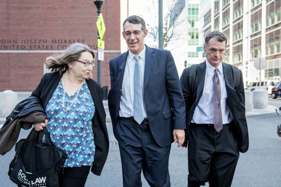 BOSTON, MA - APRIL 24:  Michael Center, former men's tennis coach for UT Austin leaves court on April 24, 2019 in Boston, Massachusetts. Center plead guilty in connection with the nationwide college admissions scandal for accepting $100,000 to help the son of a Silicon Valley venture capitalist get into the school. Photo: Scott Eisen, Getty Images / 2019 Getty Images