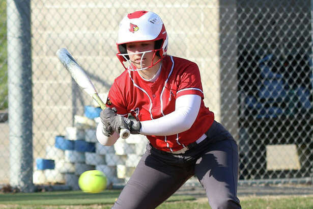 Alton's Lynna Fischer, shown taking a pitch off the plate in a game earlier this season at Alton High, was back at home Tuesday and hit a first-inning grand slam to propel the Redbirds to a SWC victory over O'Fallon.