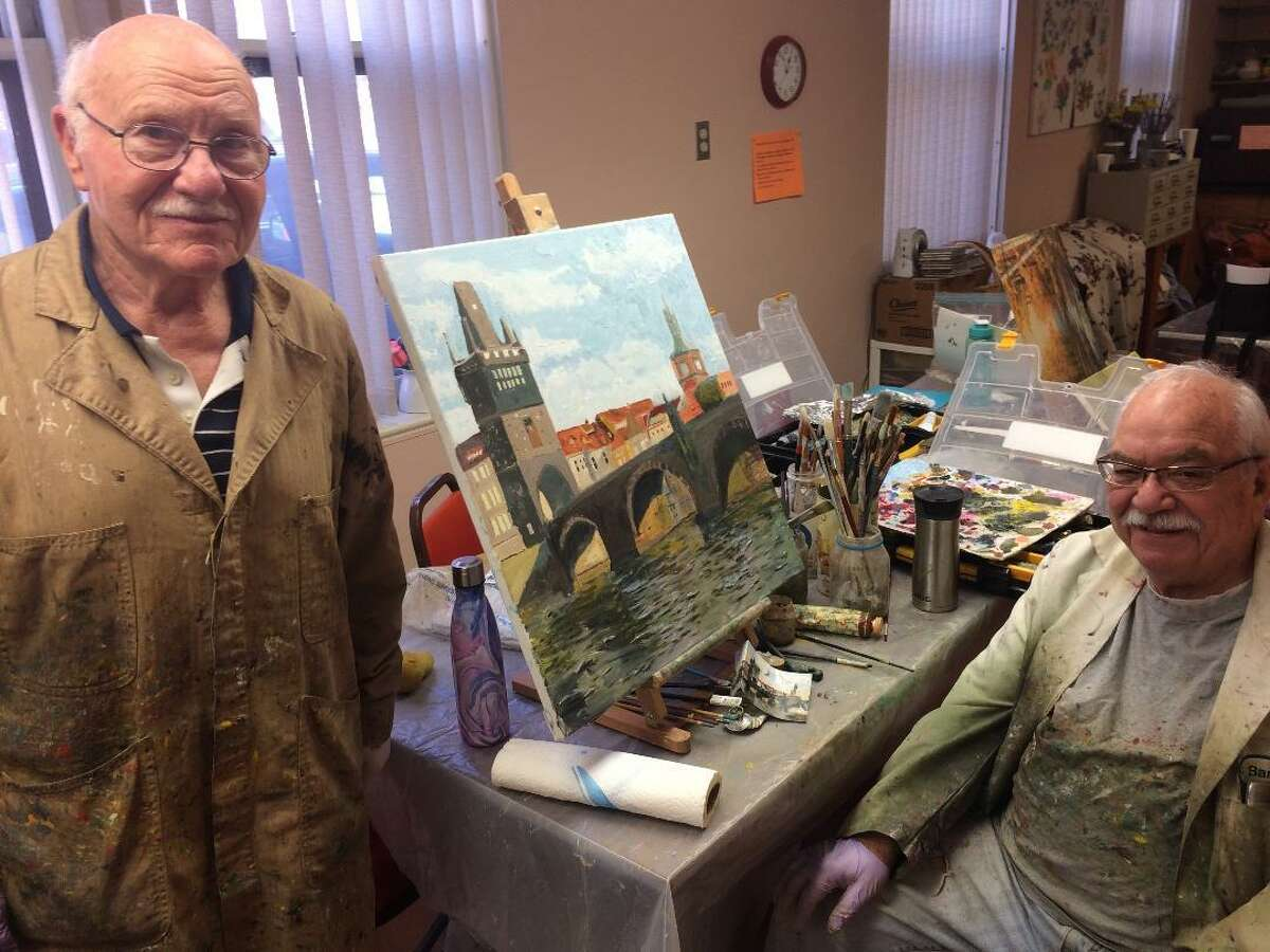 Wallace Sloves and Barry Wilensky, both of Stratford, participate in the painting program at the Derby Senior Citizen Center. Both are in favor of Susan Churchill, the interim director retaining her job on a permanent basis. The city announced this week the position was opened and applications are being accepted.