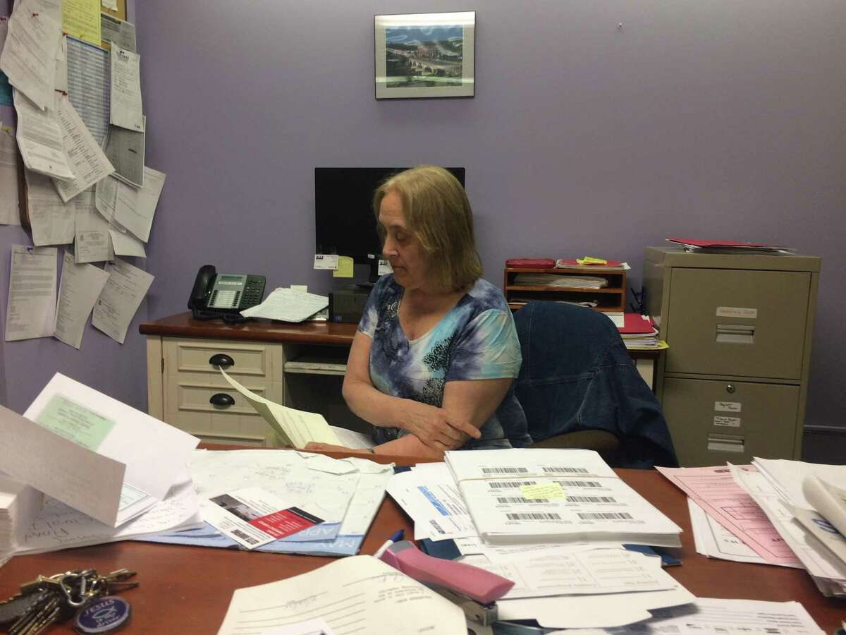 Susan Churchill, Derby's interim Senior Citizen director for the past three and a half years, looks over her programming schedule. The city this week announced it is accepting applications for the position.