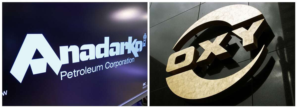This combo of file photos shows the logo for Anadarko Petroleum Corp. on the floor of the New York Stock Exchange on April 12, 2019, left, and a logo on the Occidental Petroleum building in Los Angeles on Jan. 26, 2010.