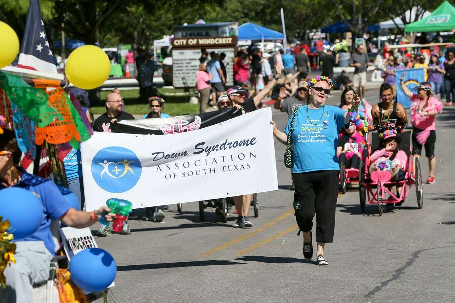 The Down Syndrome Association of South Texas and other entries proceed in front of Windcrest City Hall in the Fiesta Especial parade on Saturday. Photo: Marvin Pfeiffer /Staff Photographer / Express-News 2019