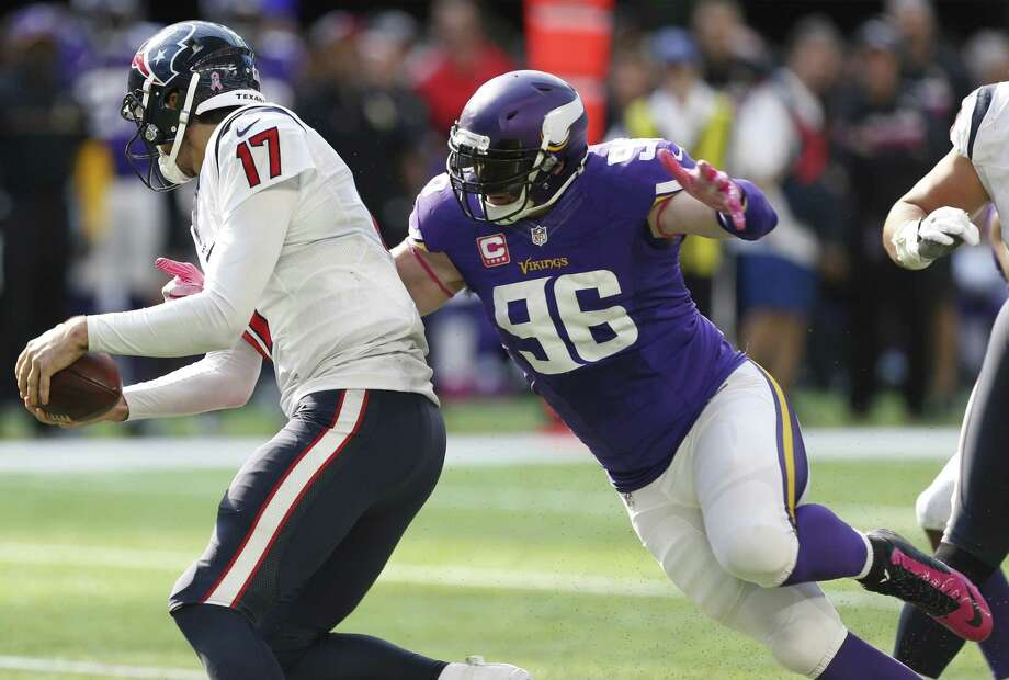Minnesota Vikings defensive end Brian Robison (96) hits Houston Texans quarterback Brock Osweiler (17) on a pass play during the fourth quarter of an NFL football game at U.S. Bank Stadium on Sunday, Oct. 9, 2016, in Minneapolis. Osweiler escaped the sack and threw the ball away for an incomplete pass. Photo: Brett Coomer, Staff / Houston Chronicle / © 2016 Houston Chronicle