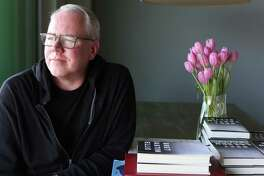 """Bret Easton Ellis at his home in West Hollywood, with copies of his new essay collection, """"White."""""""