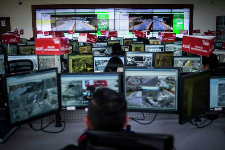 A control room of camera feeds and workers, part of Ecuador's Emergency Response System, in Ecuador in 2018. Cameras across the country send footage to monitoring centers like this one to be examined by police and domestic intelligence. The surveillance system's origin: China. (Jonah Kessel/The New York Times) -- NO SALES; FOR EDITORIAL USE ONLY WITH NYT STORY ECUADOR CHINA SURVEILLANCE BY PAUL MOZUR, JONAH M. KESSEL AND MELISSA CHAN FOR APRIL 24, 2019. ALL OTHER USE PROHIBITED. --