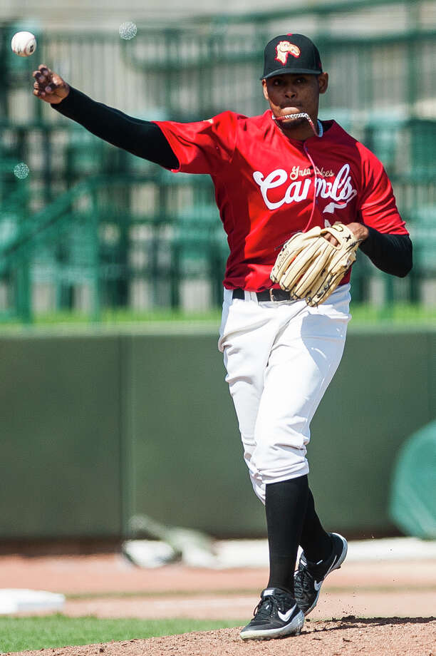Great Lakes Loons pitcher Guillermo Zuniga throws the ball to first base during a game against the West Michigan Whitecaps on Wednesday, April 24, 2019 at Dow Diamond. (Katy Kildee/kkildee@mdn.net) Photo: (Katy Kildee/kkildee@mdn.net)