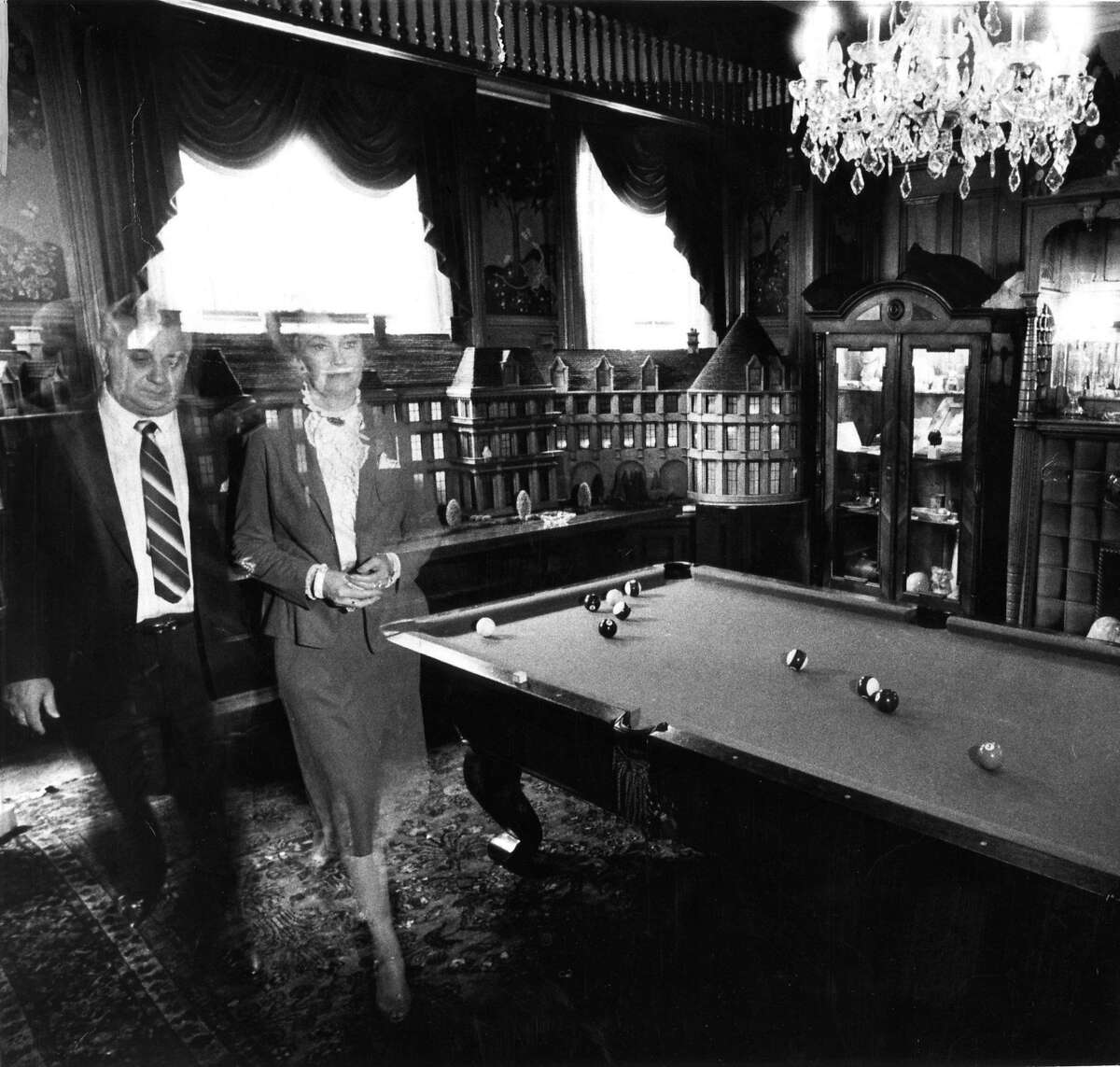 """Ed and Lorraine Warren at the Masions Hotel on Sacramento Street in S.F. Perhaps the most famous case investigated by the Warrens, the case known as the """"Amityville Horror"""" went on to launch its own multi-million dollar franchise before appearing in the second """"Conjuring"""" movie. George and Kathy Lutz claimed they were driven out of their Long Island home in 1975 by a violent paranormal entity. A year before the Lutz family moved into the home, it was reported that Ronald DeFeo Jr. shot and killed six family members in the house. The Warrens investigated the home and claimed that it was """"haunted."""" However, further investigations have revealed that the reported happenings in the home were mostly a hoax."""