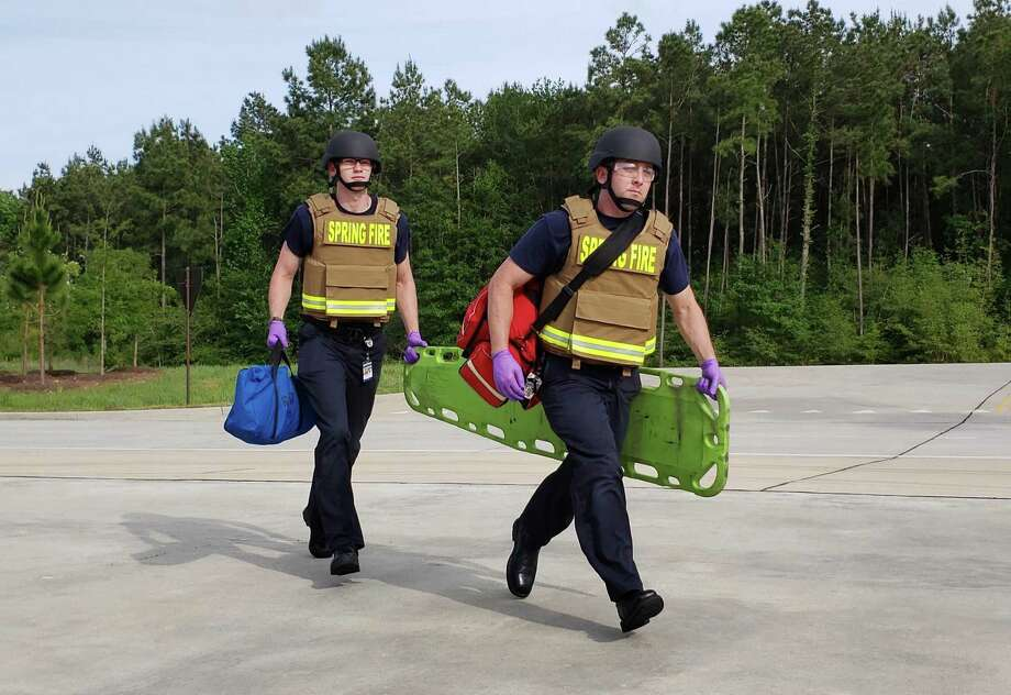 Spring Fire Department firefighters Walker Kuykendall (left) and Jay Villalobos train with the the new ballistics gear consisting of a vest and helmet. Photo: Courtesy Of Spring Fire Department