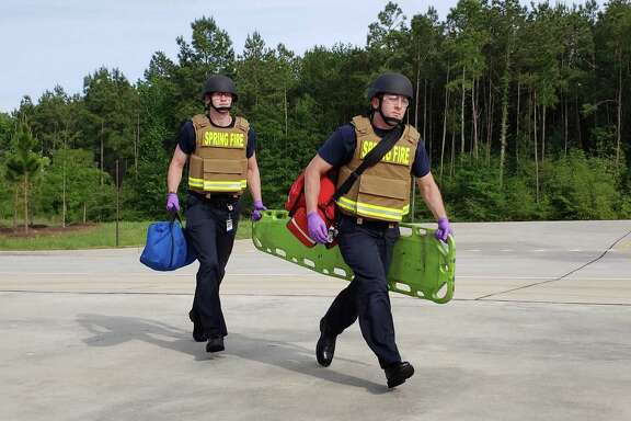 Spring Fire Department firefighters Walker Kuykendall (left) and Jay Villalobos train with the the new ballistics gear consisting of a vest and helmet.