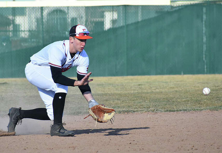 Jack Cooper fields a ground ball while playing shortstop for the Edwardsville Tigers early in the regular season. Photo: Matt Kamp/The Intelligencer