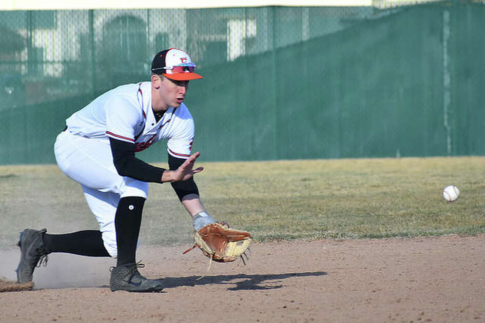 Jack Cooper fields a ground ball while playing shortstop for the Edwardsville Tigers early in the regular season.